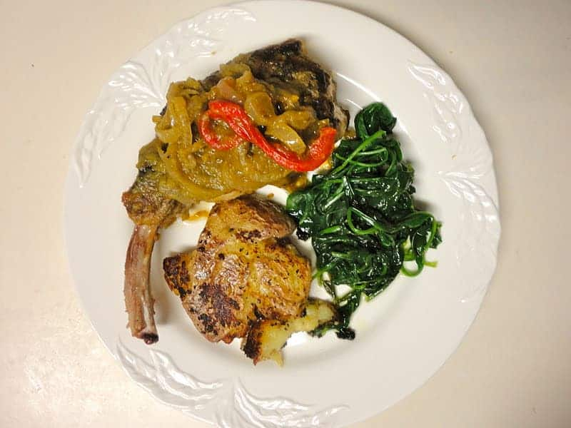 Spicy Pork Chops with Green Chiles, Roasted Red Peppers and Onions Adapted from Fine Cooking Magazine