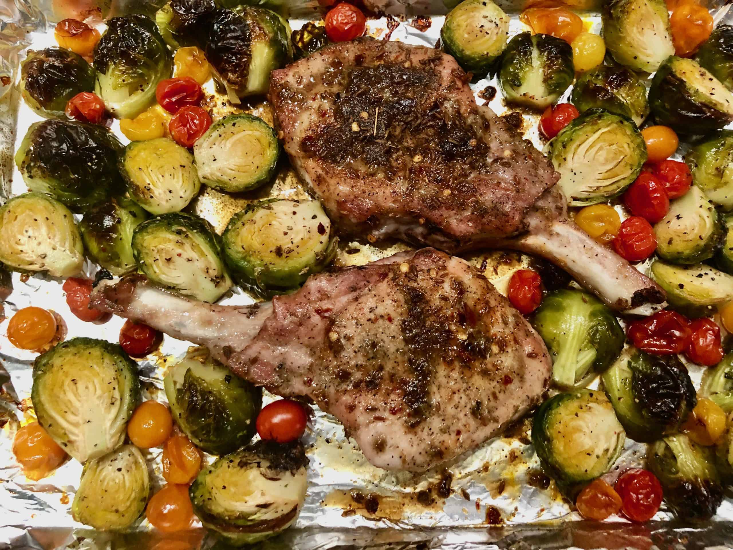 Sheet Pan Dinner: Cumin Pork Chops with Maple-Glazed Brussels Sprouts and Tiny Tomatoes.
